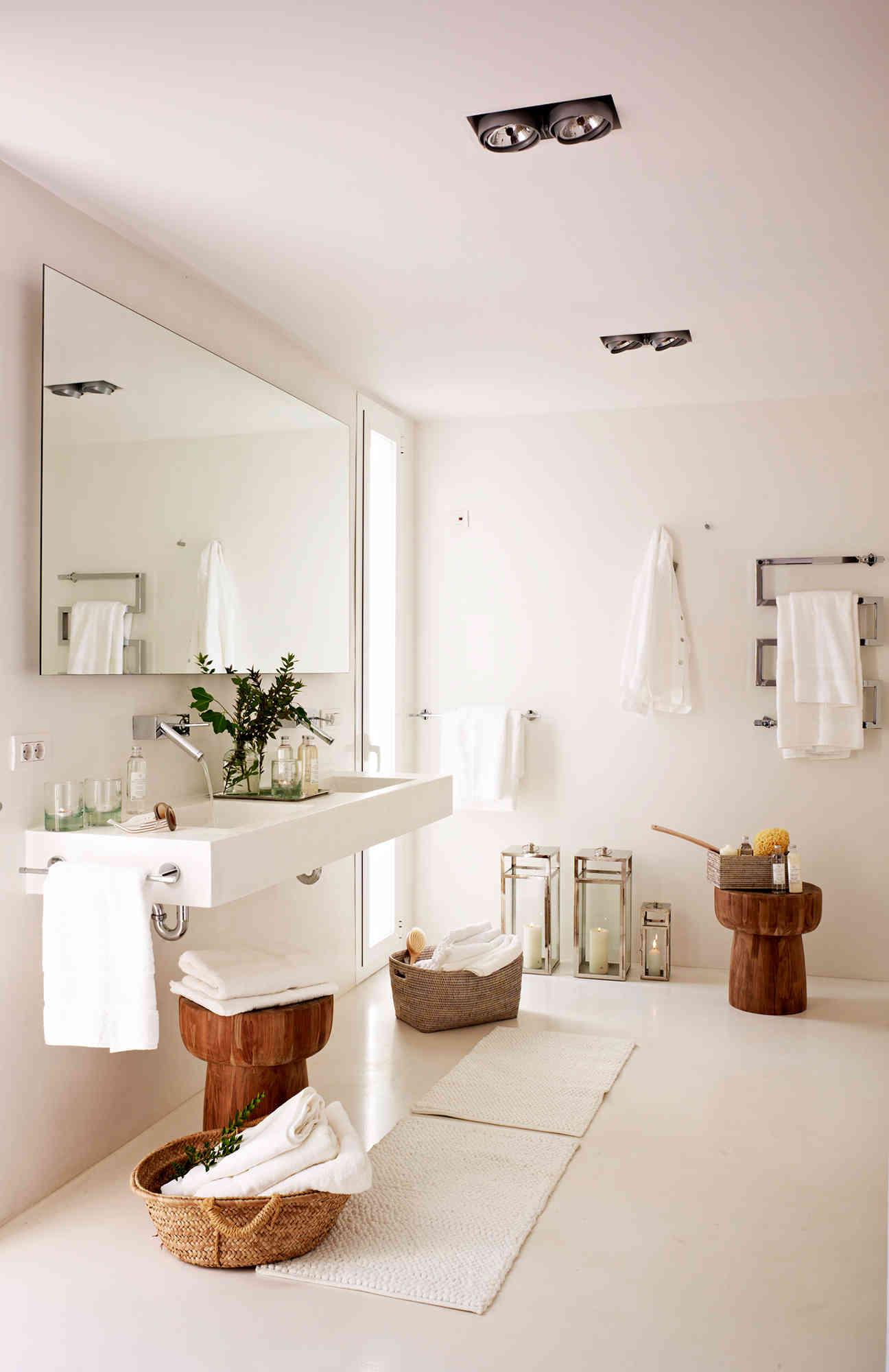 1 bano blanco moderno con encimera volada y radiador toallero en forma de zig zag fontaneros madrid reparaciones urgentes madrid